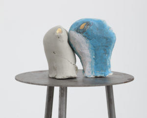 Marisa Merz, Untitled, 1994, 2 painted unfired heads and iron tripod. Heads: 16 x 16 x 12cm; each tripod: 150 x 50 x 50cm. Photo: David Regen © Marisa Merz. Courtesy Gladstone Gallery, New York and Brussels.