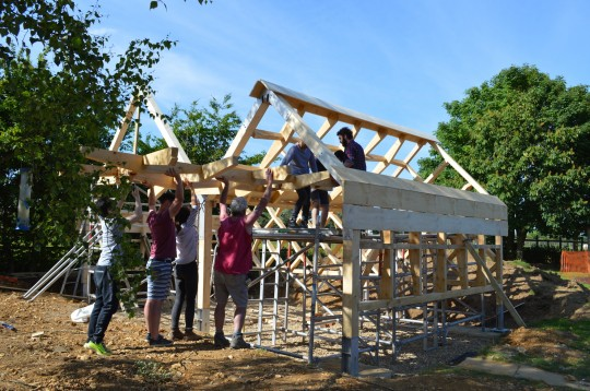 Volunteers helping to raise the roof of the music pavilion at S. John's School in Lacey Green, Bucks (2015. WORKSHOP architecture.