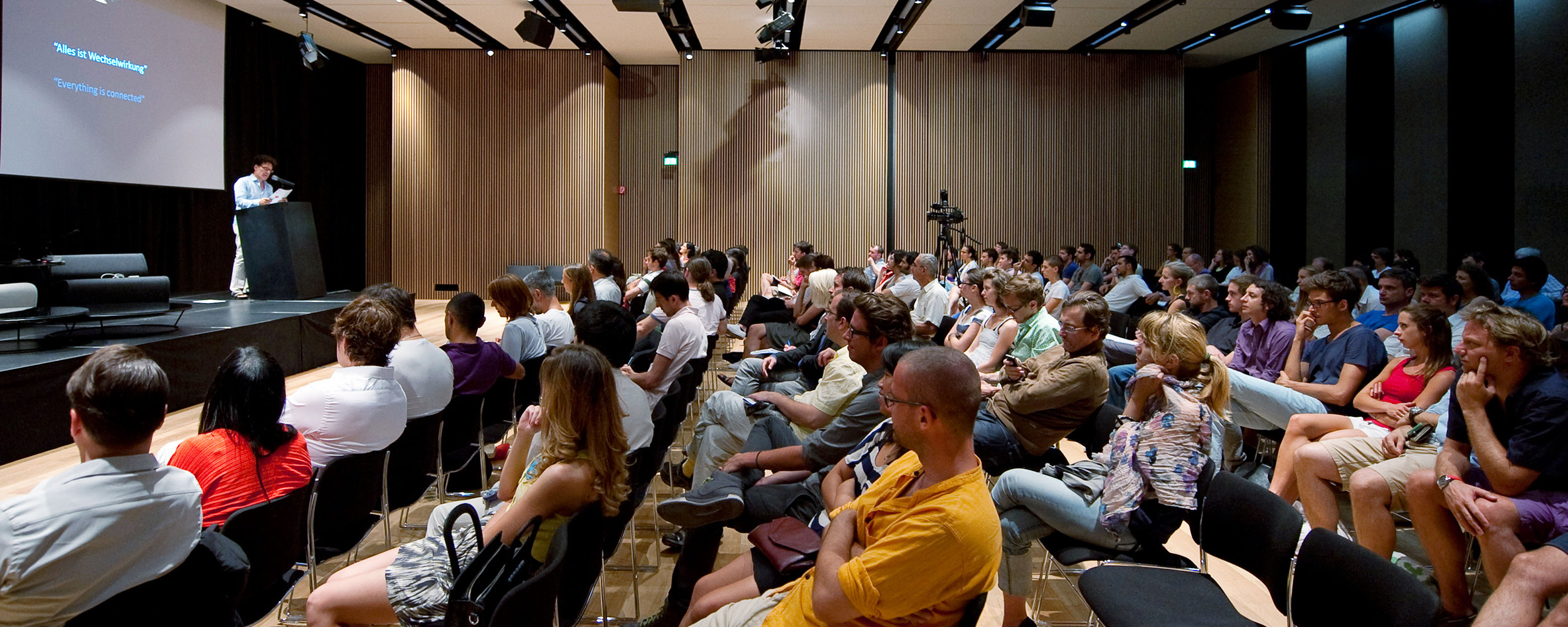 Audience watching Sanford Kwinter, Speculative Materialism in Architecture symposium, 2011, in the auditorium, Hotel Lone, Rovinj, © MLAUS.