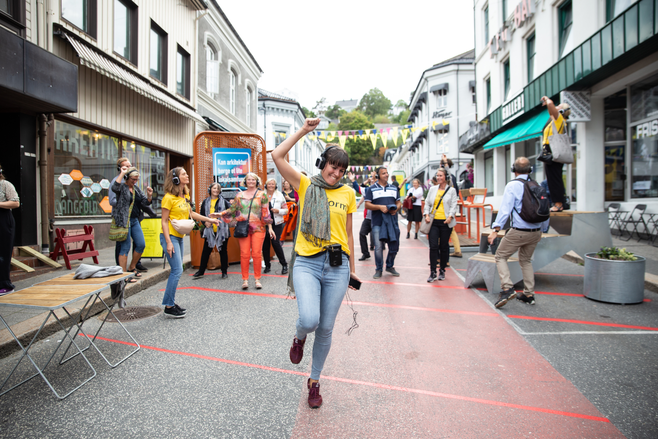 Experiencing a performative audio walk at Arendalsuka, Norway, based on your choice of urban future, part of OAT's events testing ideas and formats, 2018, ahead of the 2019 Triennale. © Arendalsuka/Mona Hauglid.