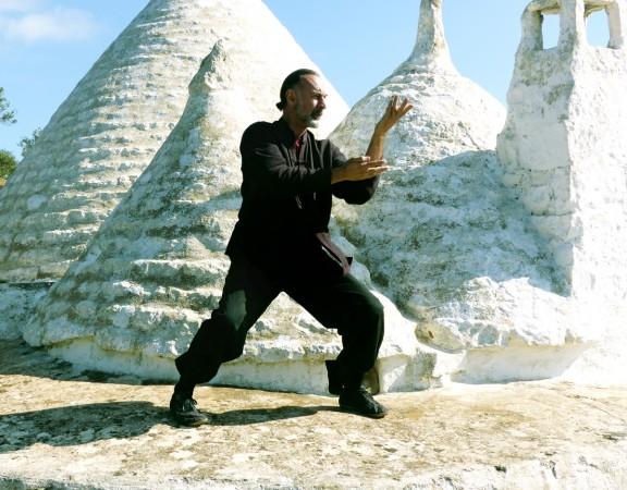 Dancing in Puglian trullo setting.