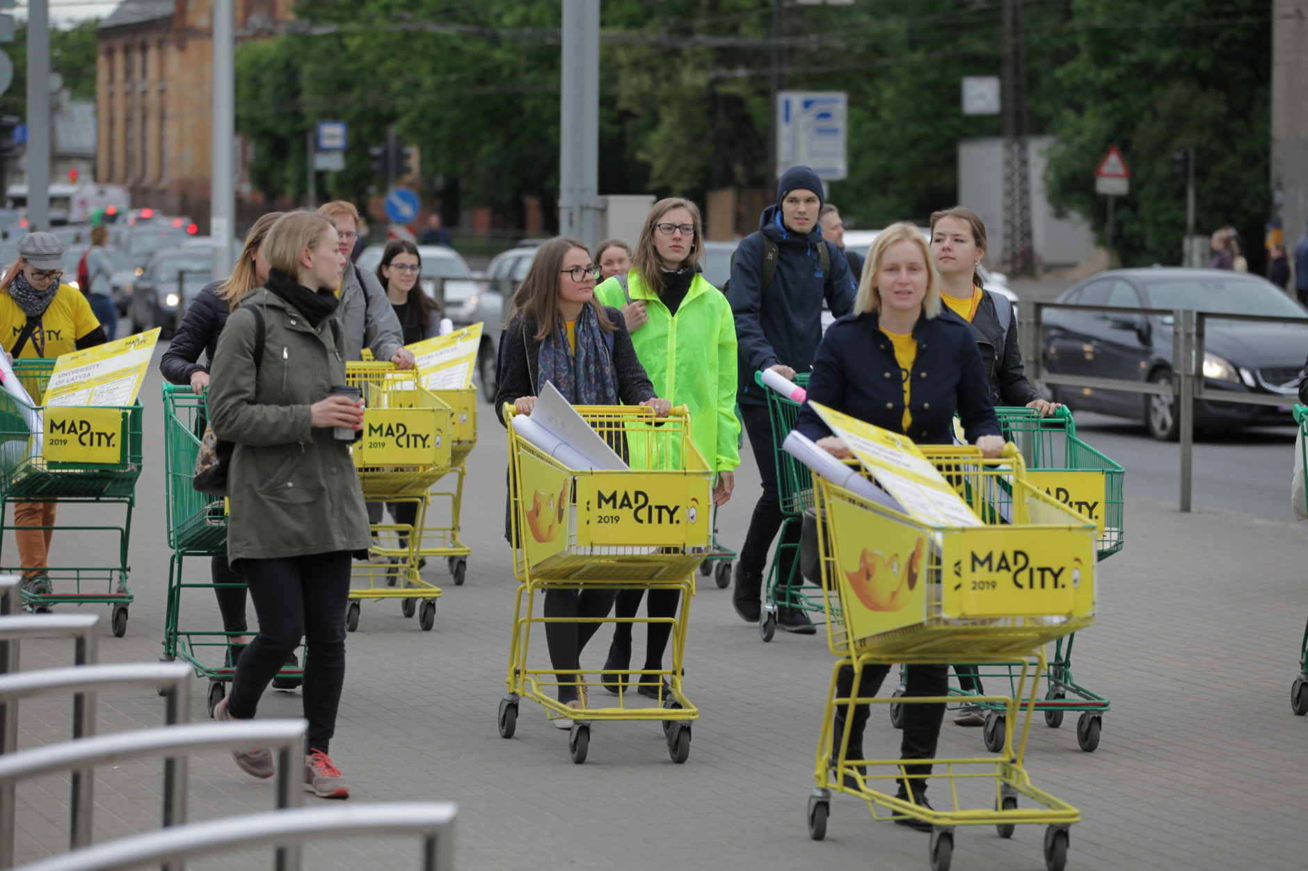 Participants in the hackathon at Mad City, May 2019, trundle shopping trolleys along a testing terrain to their designated hackathon workspace in the Riga Knowledge Mile, Mad City, 2019, Riga, Latvia.